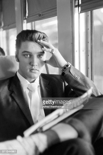Alfred Wertheimer/Getty Images Portrait of American musician Elvis Presley as he sits on the New York to Memphis train July 4 1956 Elvis had been in...