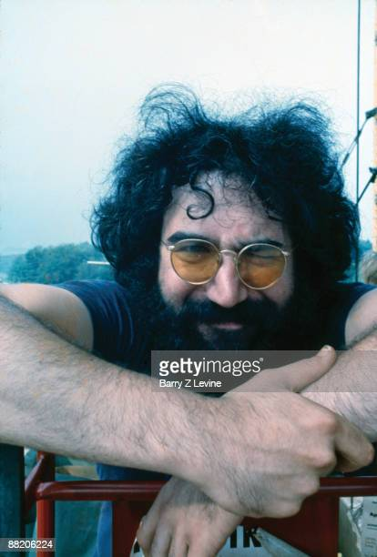 Portrait of American musician Jerry Garcia from the band the Grateful Dead backstage at the Woodstock Music and Arts Fair in Bethel New York August...
