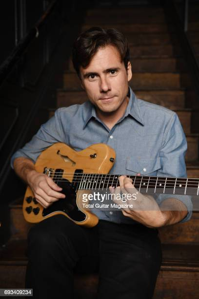 Portrait of American musician Jim Adkins guitarist and vocalist with rock group Jimmy Eat World photographed before a live performance at The Scotch...