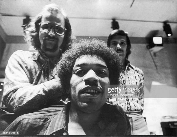 Portrait of American musician Jimi Hendrix South Africanborn American music producer and engineer Eddie Kramer and studio manager Jim Marron as they...