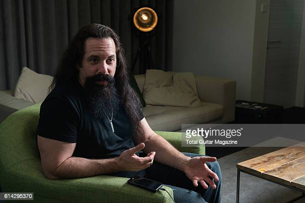 Portrait of American musician John Petrucci, guitarist with progressive metal group Dream Theater, photographed during an interview in London, on...