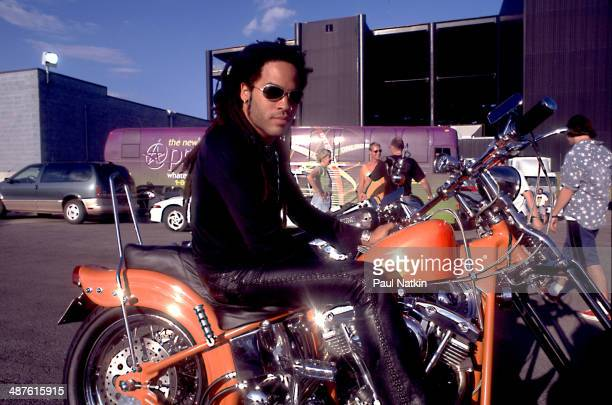 Portrait of American musician Lenny Kravitz as he sits on a motorcycle Chicago Illinois June 7 1996