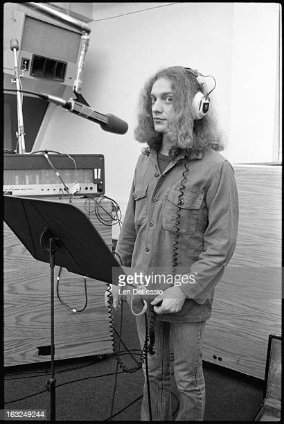 Portrait of American musician Lou Gramm of the band Foreigner in the vocal booth at Atlantic Recording Studios during the recording of his band's...