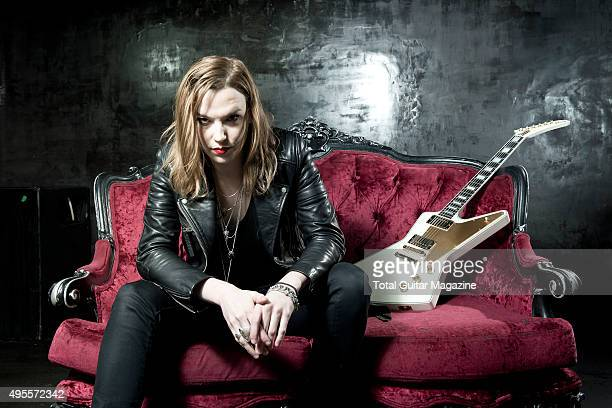 Portrait of American musician Lzzy Hale guitarist and vocalist with hard rock group Halestorm photographed before a live performance at Rock City in...