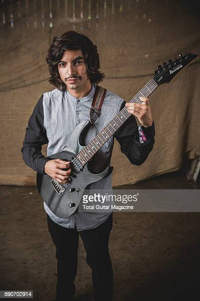 Portrait of American musician Mario Camarena guitarist with progressive rock group Chon photographed backstage at ArcTanGent Festival in Somerset on...