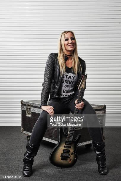 Portrait of American musician Nita Strauss, photographed backstage during the UK Guitar Show at the Olympia in London, on September 30, 2018. Strauss...