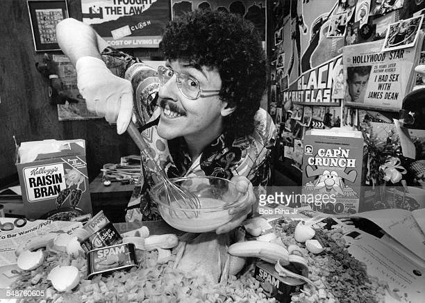 Portrait of American musician parodist and comedian Weird Al Yankovic as he poses with various food items during a photo shoot Los Angeles California...