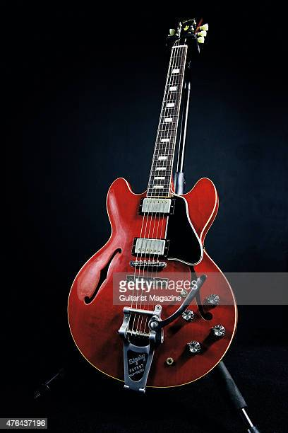Portrait of American musician Rich Robinson photographed with his signature Gibson Memphis Rich Robinson ES335 electric guitar in London on June 17...