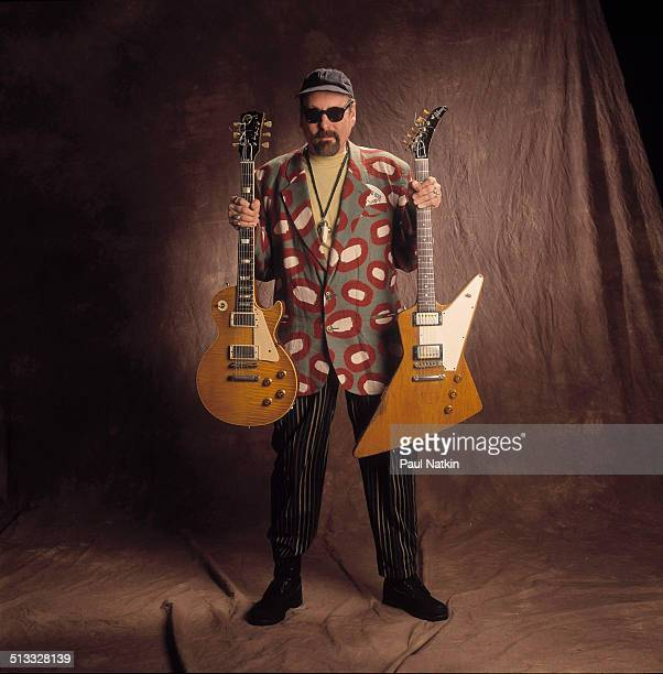 Portrait of American musician Rick Nielsen of the band Cheap Trick poses with two of his guitars Chicago Illinois February 12 1994