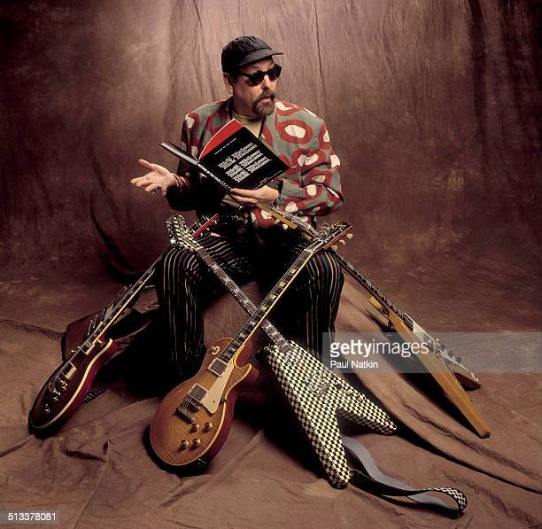 Portrait of American musician Rick Nielsen of the band Cheap Trick poses with four of his guitars Chicago Illinois February 12 1994