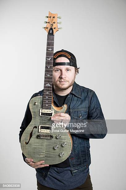 Portrait of American musician Zach Myers guitarist with hard rock group Shinedown photographed with his PRS SE Zach Myers electric guitar at Holborn...