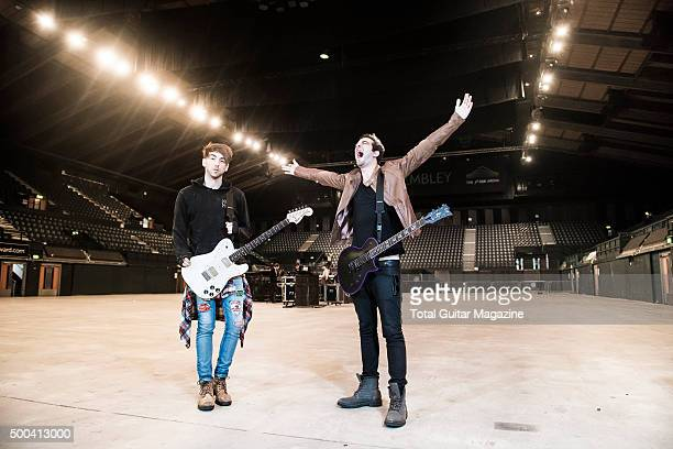 Portrait of American musicians Alex Gaskarth and Jack Barakat guitarists with pop punk group All Time Low photographed before a live performance at...