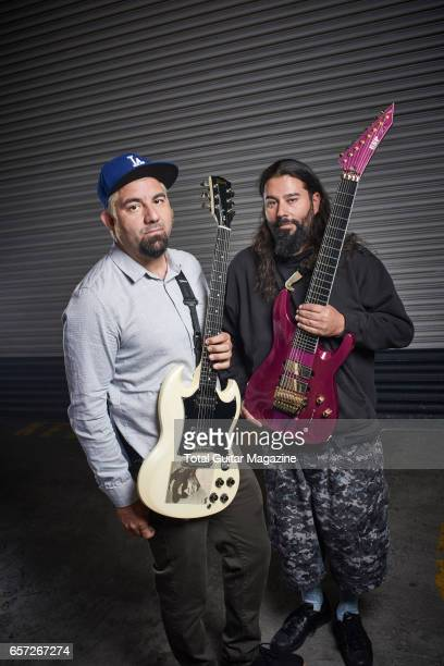 Portrait of American musicians Chino Moreno and Stephen Carpenter guitarists with alternative metal group Deftones photographed backstage before a...