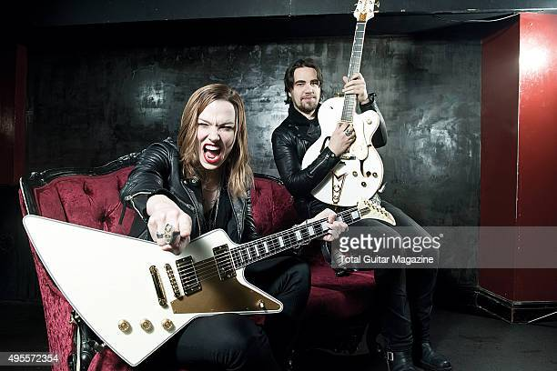 Portrait of American musicians Lzzy Hale and Joe Hottinger guitarists with hard rock group Halestorm photographed before a live performance at Rock...