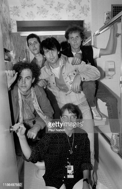 Portrait of American New Wave group the Swimming Pool Q's as they pose backstage at the Bismarck Theatre Chicago Illinois May 2 1986 Pictured are...