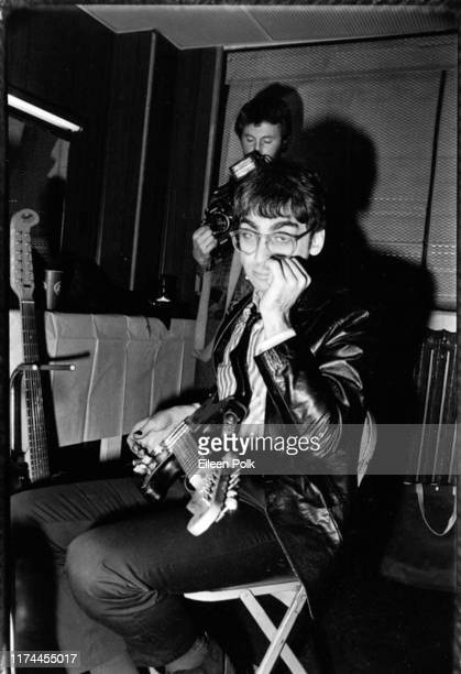 Portrait of American New Wave musician Chris Stein of the group Blondie as he sits with his guitar backstage at the Palladium New York New York late...