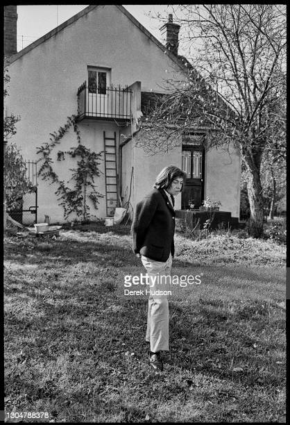 Portrait of American novelist and short story writer Patricia Highsmith as she stands in the garden of her home, in the village of...