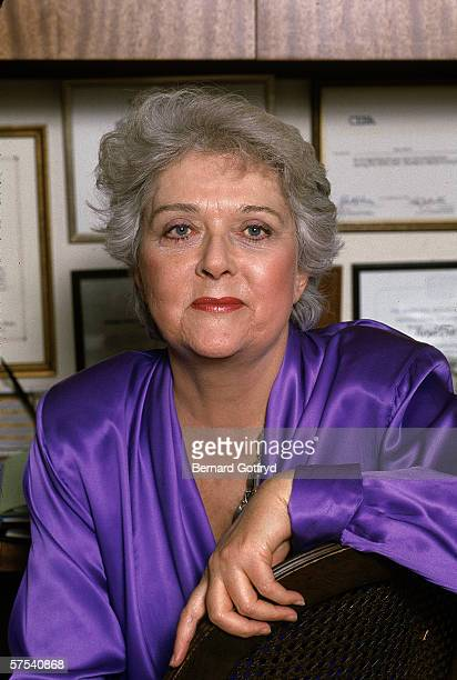 Portrait of American novelist Ellen Currie author of 'Moses Supposes' wearing a purple satin blouse 1980s