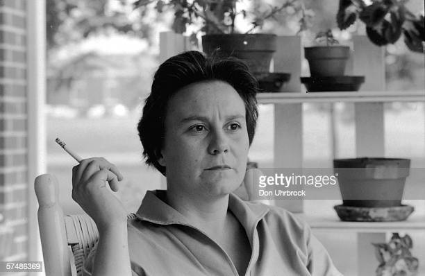 Portrait of American novelist Harper Lee smokes a cigarette as she sits on the porch of her parents home, Monroeville, Alabama, May 1961. Lee's novel...