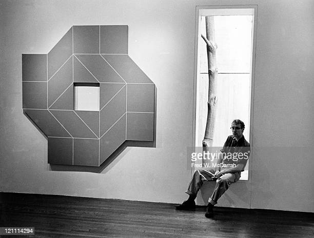Portrait of American painter and sculptor Will Insley as he poses next to one of his works during the preparation for an exhibition at the Stable...