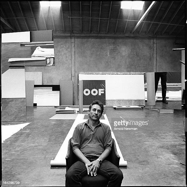 Portrait of American painter Ed Ruscha as he poses in his studio Los Angeles California November 11 1985 The word 'Oof' appears in large font on a...