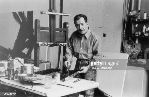 Portrait of American painter Franz Kline as he mixes paint in his studio New York New York April 7 1961