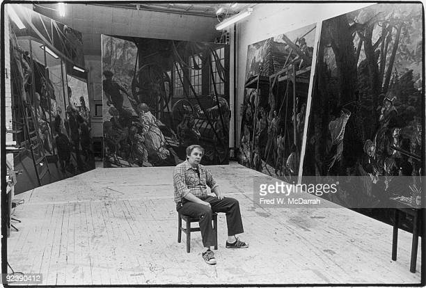 Portrait of American painter Jack Beal as he sits surrounded by four of his mural paintings collectively titled 'The History of Labor' December 29...