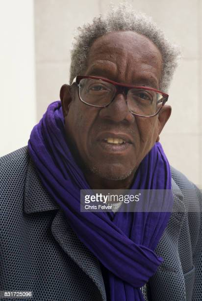 Portrait of American painter Stanley Whitney in a coat and purple scarf Venice Italy 2017