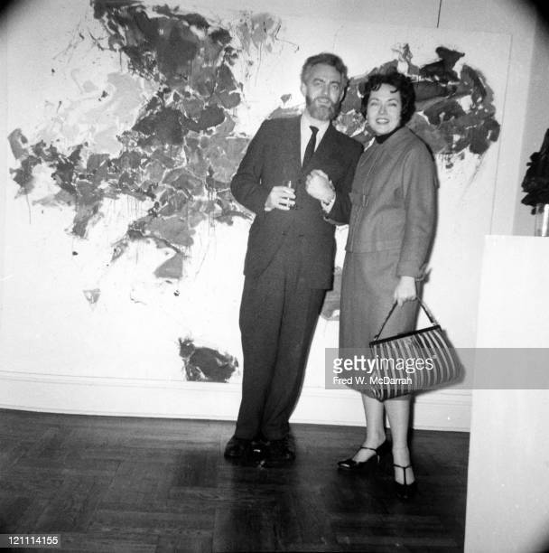 Portrait of American painters Paul Jenkins and Alice Baber as they pose together during an exhibition at the Tibor de Nagy Gallery New York New York...