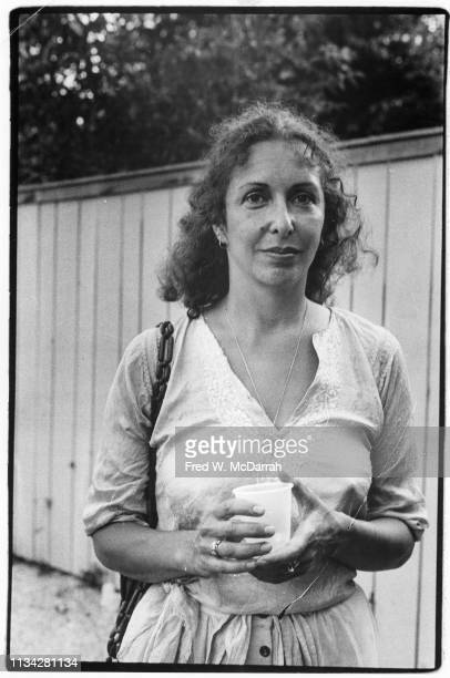 Portrait of American performance and visual artist Carolee Schneemann as she poses during an opening at the Elaine Benson Gallery Bridgehampton New...