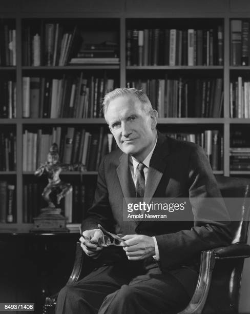 Portrait of American philanthropist John D Rockefeller III as he sits in a library New York New York June 11 1964