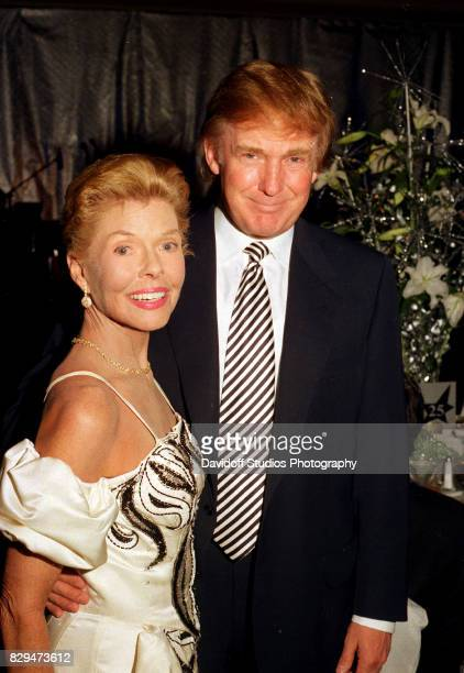 Portrait of American philanthropist Lois Pope and real estate developer Donald Trump as they pose together during 'Lady in Red' gala at the Breakers...