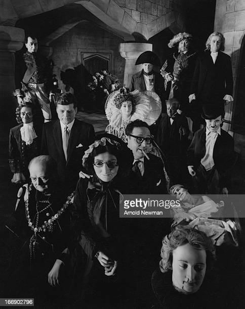 Portrait of American photographer Arnold Newman as he poses cigar in mouth with exhibits at Madame Tussauds wax museum London England 1961