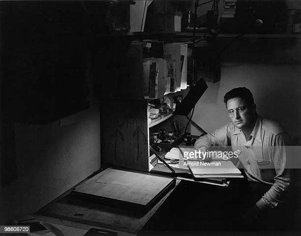 Portrait of American photographer Arnold Newman as he writes at a desk Miami Beach Florida April 2 1943
