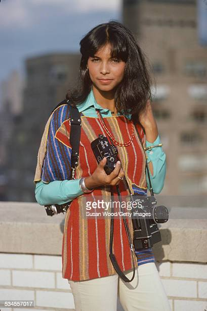 Portrait of American photographer Jeanne MoutoussamyAshe as she poses outdoors with her cameras October 1977 Earlier that year she married tennis...