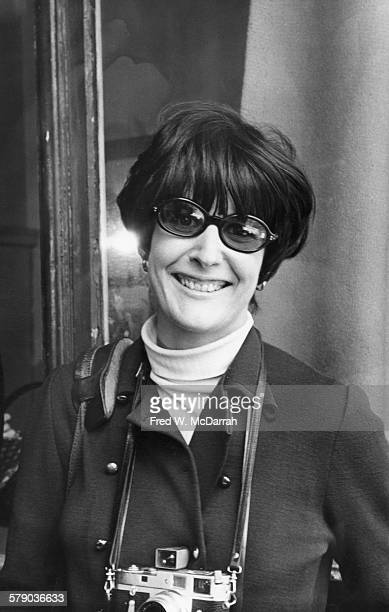 Portrait of American photographer Jill Krementz as she poses with a camera around her neck New York New York April 27 1969