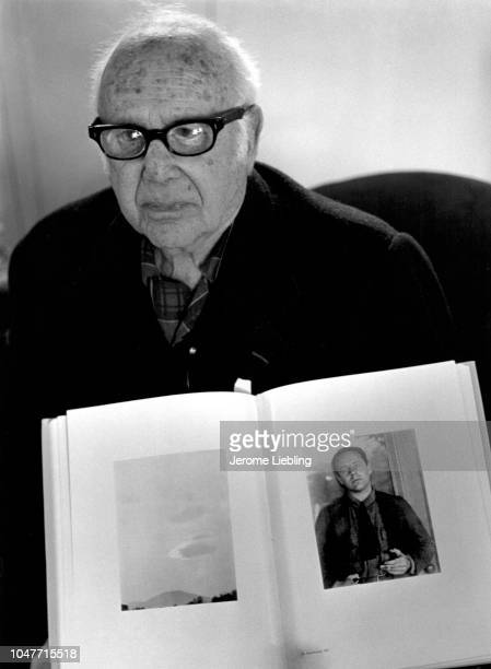 Portrait of American photographer Paul Strand Paris France 1974 In the foreground is a book open to a portrait of himself taken by Alfred Stieglitz...