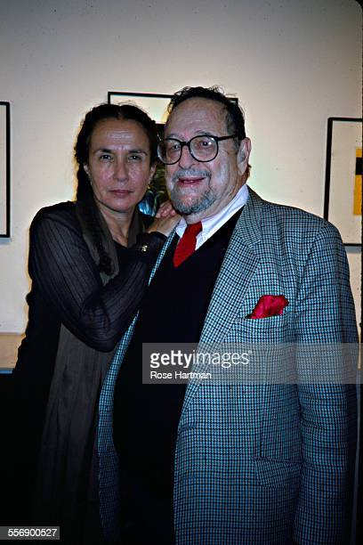 Portrait of American photographers Mary Ellen Mark and Arnold Newman as they attend a gallery show in Soho New York New York 2002