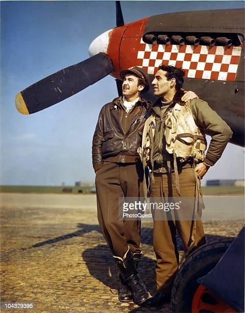 Portrait of American pilots Major Don Gentile and his wingman Captain John T Godfrey as they pose next to Gentile's plane a North American Aviation...