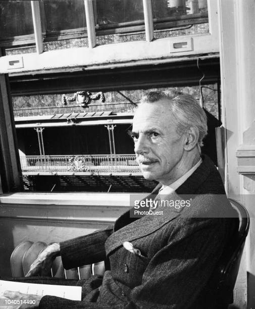 Portrait of American playwright Eugene O'Neill as he sits beside an open window, New York, New York, 1950.