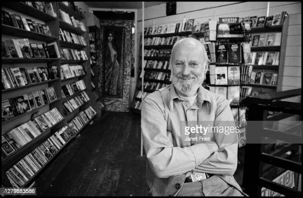 Portrait of American poet and activist Lawrence Ferlinghetti as he poses in the bookstore he co-founded, City Lights Booksellers, in the North Beach...