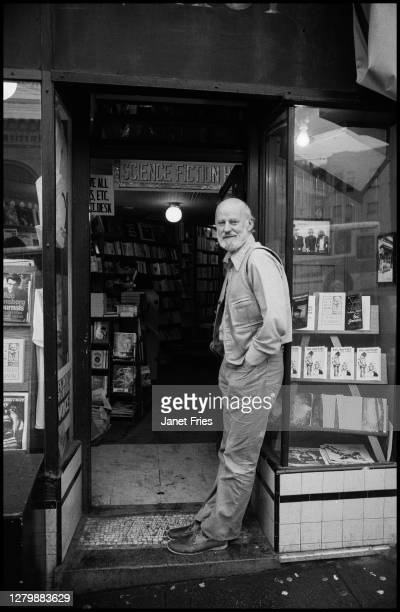 Portrait of American poet and activist Lawrence Ferlinghetti as he poses in the doorway of the bookstore he co-founded, City Lights Booksellers, in...