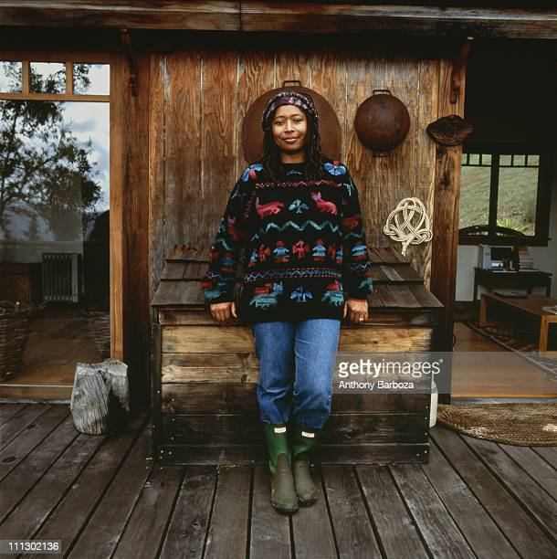 Portrait of the poet and Pulitzer prize winning author Alice Walker standing in front of her writing house on the grounds near her home in San...