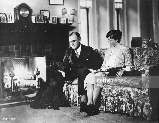 Portrait of American politician and US President Franklin D Roosevelt and his wife First Lady Eleanor Roosevelt as they pose at home with their dogs...