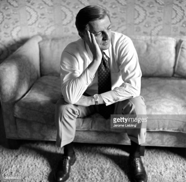 Portrait of American politician and US Senator Walter Mondale his head in his hand as he sits on a couch in a suite at the Americana Hotel New York...