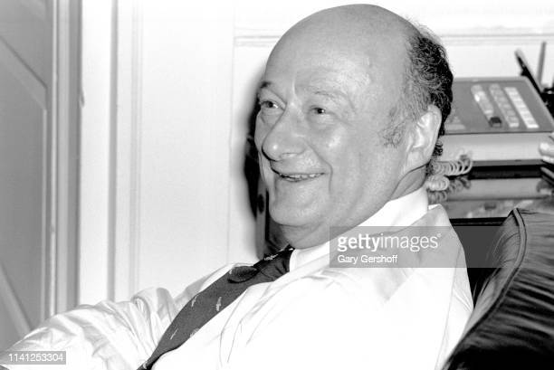 Portrait of American politician New York City Mayor Ed Koch as he smiles seated in a chair in New York City Hall New York New York January 23 1980