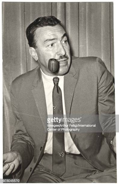 Portrait of American politician religious leader and social activist Adam Clayton Powell Jr as he smokes a pipe mid twentieth century Photo by Weegee...
