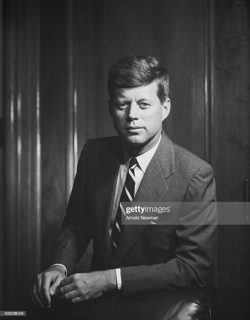 Portrait of John F. Kennedy, facing right, seated at his