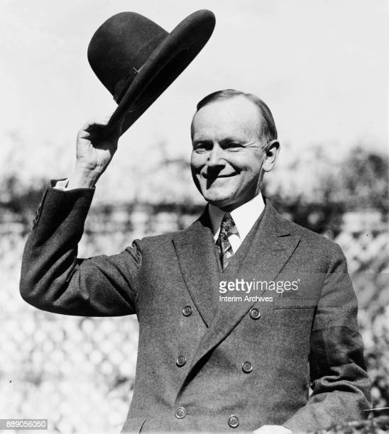 Portrait of American politician US President Calvin Coolidge as he smiles and doffs his hat October 2 1924