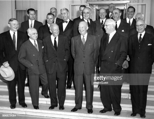 Portrait of American politician US President Dwight D Eisenhower as he poses with members of the US Supreme Court and Justice Department Washington...